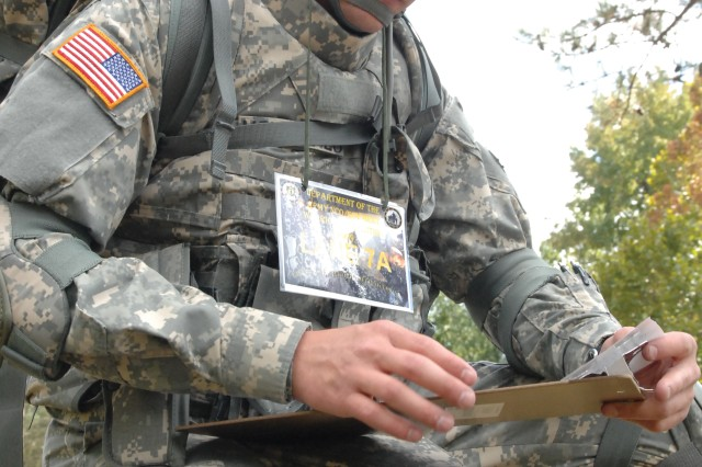 Spc. Guy Mellor, the National Guard Soldier of the Year, takes a knee while plotting a way point at the start of the Urban Warfare Orienteering Course on Sept. 30, at the 2009 Department of the Army Best Warrior Competition.