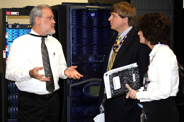 Charlie Wilcox, USASMDC/ARSTRAT Simulation Center program manager, left, talks with Ben Matthews, project manager, and Cathy Hatchett, security manager, both with GaN Corporation. GaN Corporation was recently awarded an 8(a) Competitive Set-Aside contract to operate and maintain the FWC Simulation Center.