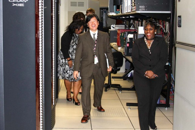 Dr. Jonn Kim, president and CEO of GaN Corporation, and Dr. Claudette Owens, chief, Information and Computational Engineering Division, USASMDC/ARSTRAT, tour the Simulation Center. Alabama-based GaN Corporation was recently awarded a contract to operate and maintain the FWC Simulation Center.