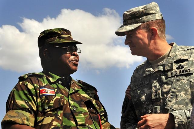 MANZINI, Swaziland -- Umbutfo Swaziland Defence Force (USDF) Lt. Col. Moses Swane speaks with U.S. Army Africa Commander Maj. Gen. William Garrett III on on Aug. 13, 2009, during the MEDFLAG 09 medical training exercise.