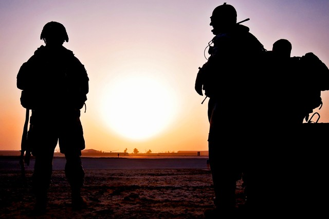 Soldiers wait in the early morning for two UH-60 Black Hawk helicopters to pick them and bring them to a nearby town to conduct a patrol in Taji, Iraq, Sept. 18, 2009. The United States may be able to draw down troop levels in Iraq quicker than anticipated if progress continues there, the commander of U.S. and coalition forces in Iraq said recently.