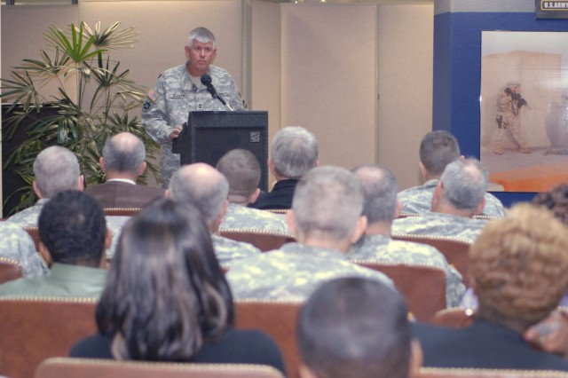 Addressing the gathered crowd, Maj. Gen. Mark Graham shares his familyAca,!a,,cs experience with suicide and tragedy. After losing son Kevin to suicide in June 2003, son Jeffrey was killed by an IED in Iraq seven months later.