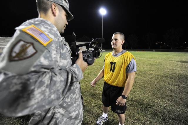 Spc. Shiloh Becher is interviewed by Spc. Jeremiah Richardson after the Army Physical Fitness Test at the Department of the Army Best Warrior Competition at Fort Lee, Va. on Wednesday, Sept. 30, 2009. Becher is the Army Reserve Soldier of the Year.