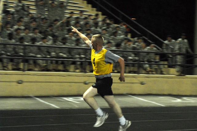 Staff Sgt. Arron Butler works the crowd during the Army Physical Fitness Test (APFT). The twenty contestants in the Best Warrior Competition start the second day of competition in front of hundreds of cheering Initial Entry Training Soldiers with a competitive APFT.