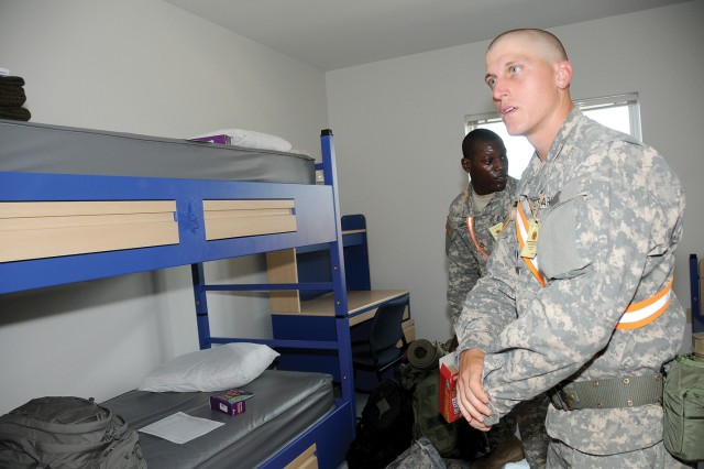 Pvt. Akeim Scarborough and Spc. Owen Scott move into their new room at the Ordnance School barracks.