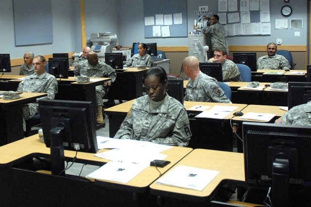 Noncommissioned Officers attending BNCOC phase 1 at Fort Stewart take a break in the classroom while their instructors prepare for the next segment of training. The current iteration is the final BNCOC phase 1 class that will be taught by the Fort Stewart NCO Academy, as the course is transitioning to an online delivery system.