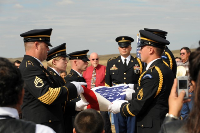 """Members of the South Dakota Army National Guard Military Funeral Honors team fold an American flag during the burial ceremony for Sgt. 1st Class Arthur F. """"Bluie"""" Jewett at St. Theresa Catholic cemetery near White Horse, S.D., Sept. 25. Jewett, a member of the Cheyenne River Sioux Tribe, was killed-in-action during the Korean War's Chosin Reservoir campaign and his remains were not identified until earlier this year."""