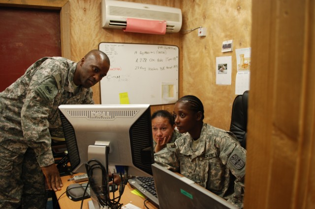 Chief Warrant Officer 4 Darren L. Cook (left), Brigade Logistics Support Team chief for the 172nd Infantry Brigade, works with Sgt. 1st Class Wendoly D. Portillo, 172nd Inf. Bde. property book office noncommissioned officer-in-charge, and Chief Warrant Officer 2 Tuajuanna N. Jones, 172nd Inf. Bde. property book officer, as the unit resets equipment in preparation for redeployment.