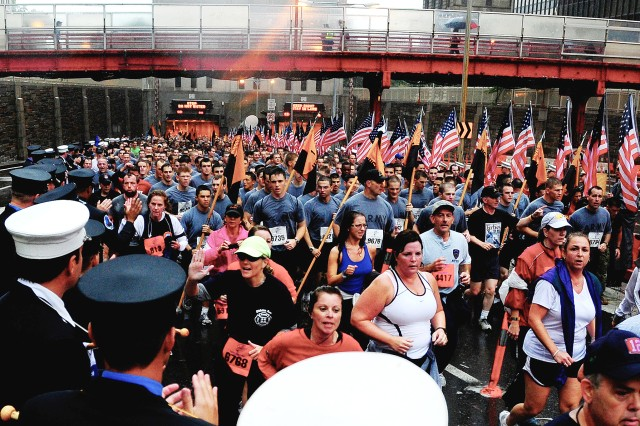Approximately 700 cadets raced through the streets of lower Manhattan during the eighth annual Tunnel to Towers Run through the Brooklyn Battery Tunnel Sunday. Running along with the cadets was Dean of the Academic Board Brig. Gen. Patrick Finnegan (black shirt and hat-right side of the photo) as well as numerous officers and noncommissioned officers from the U.S. Corps of Cadets and West Point. As the cadets ran the streets, members of Company H-1 displayed the colors as 343 firefighters held flags with the faces of the fallen firefighters of 9/11.