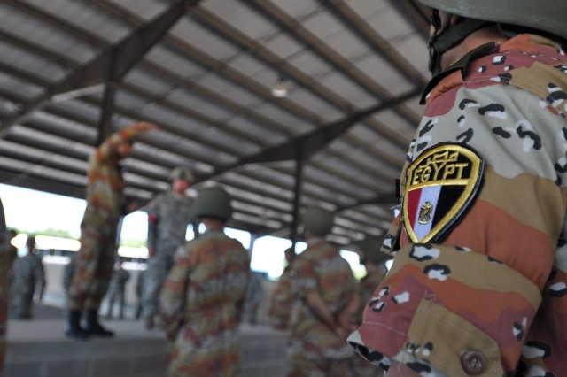 "The Egyptian flag is visible on the uniform of an Egyptian paratrooper conducting sustained airborne training at Pope Air Force Base prior to a ""friendship jump"" airborne operation featuring airborne forces from five countries, including the U.S. 82nd Airborne Division. The jump was part of the Bright Star Exercise, a joint, multi-national training exercise being held at Fort Bragg, N.C. from Sep. 28-Oct. 12."