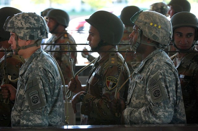 "U.S. paratroopers from the 82nd Airborne Division's 2nd Brigade Combat Team and Egyptian Soldiers conduct pre-jump rehearsals prior to a ""friendship jump"" airborne operation featuring airborne forces from five countries. The jump was part of the Bright Star Exercise, a joint, multi-national training exercise being held at Fort Bragg, N.C. from Sep. 28-Oct. 12."