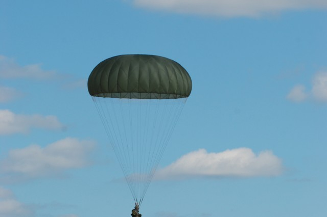 """An Egyptian paratrooper sails to the ground during a """"friendship jump"""" airborne operation at Fort Bragg, N.C. featuring airborne forces from five countries, including the U.S. 82nd Airborne Division. The jump was part of the Bright Star Exercise, a joint, multi-national training exercise being held at Fort Bragg from Sep. 28-Oct. 12."""