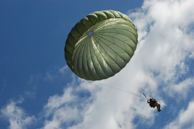"""Egyptian paratroopers sail to the ground during a """"friendship jump"""" airborne operation at Fort Bragg, N.C. featuring airborne forces from five countries, including the U.S. 82nd Airborne Division. The jump was part of the Bright Star Exercise, a joint, multi-national training exercise being held at Fort Bragg from Sep. 28-Oct. 12."""