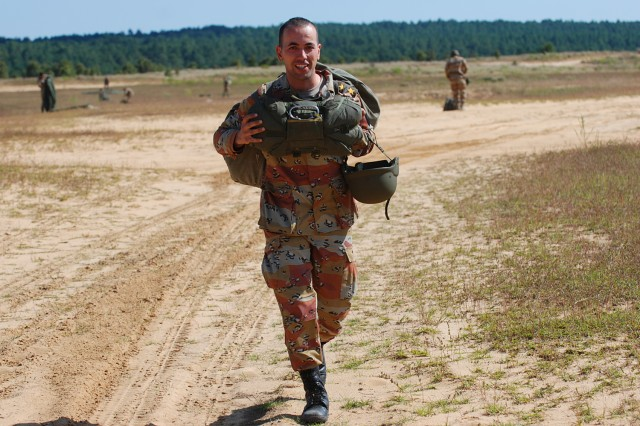 An Egyptian Army lieutenant walks off the drop zone after making a successful parachute jump at Fort Bragg, N.C. The jump was part of the Bright Star Exercise, a joint, multi-national training exercise featuring airborne forces from five countries, including the U.S. 82nd Airborne Division, being held at Fort Bragg from Sep. 28-Oct. 12.