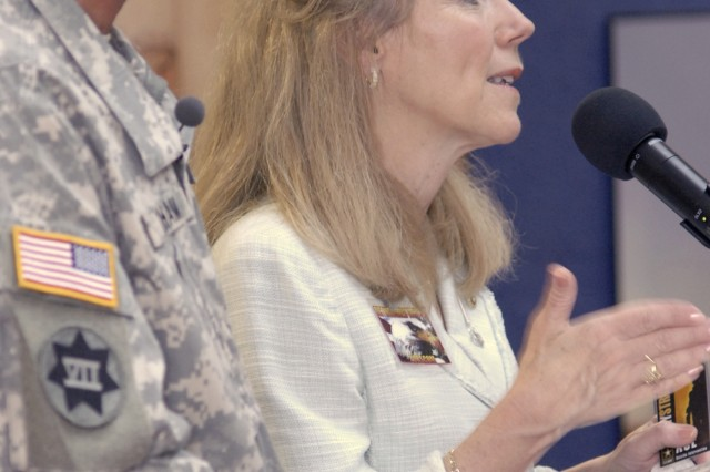 Carol Graham, the wife of Maj. Gen. Mark Graham, answers a question from the audience, openly recalling her own feelings about son KevinAca,!a,,cs depression and suicide.