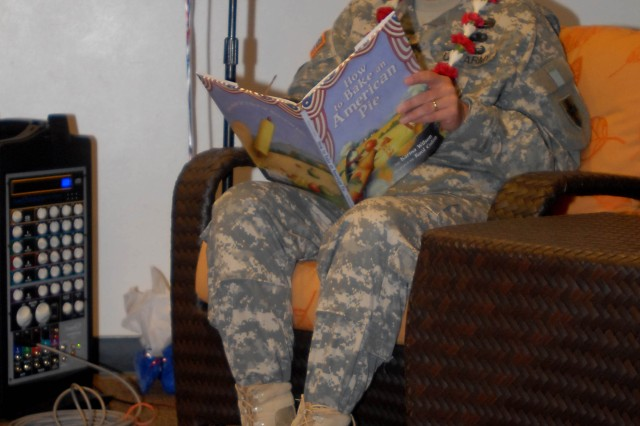 "Brig. Gen. Michael Terry, commanding general, 8th Theater Sustainment Command, reads the book How to Bake an American Pie during the  ""Tell me a Story"" event, at the Aliamanu Military Reservation community Center, Sept. 16."