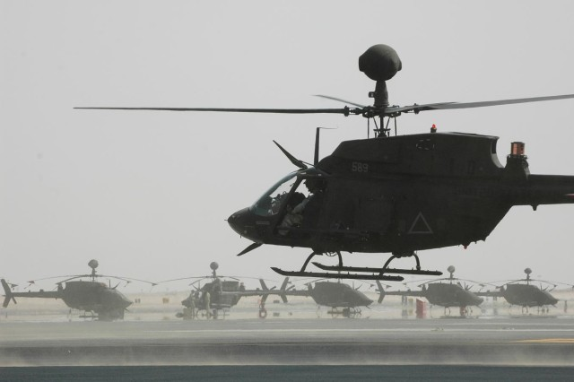 Pilots with 2nd Squadron, 6th U.S. Cavalry Regiment, 25th Combat Aviation Brigade, fly their OH-58 D Kiowa Warrior from the flight-line to the rearming point during training at Camp Buehring, Kuwait, Sept. 18.