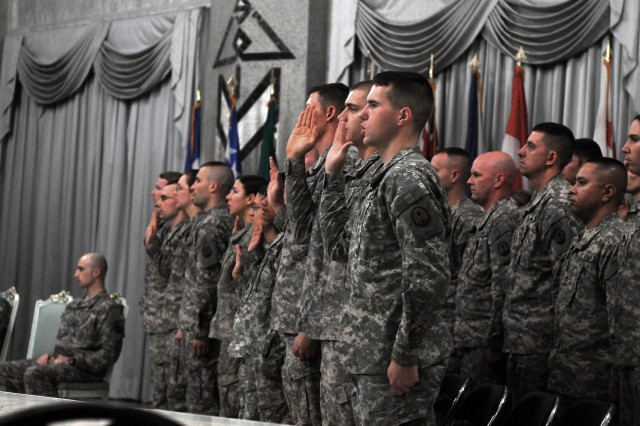 Twenty-one Soldiers stand shoulder to shoulder reciting the Creed of the Noncomissioned Officerduring the I Corps Trailblazer NCO Induction Ceremony held at the Al Faw Palace ballroom, Camp Victory Sept. 26. Mutli-National Force-Iraq Command Sergeant Major Lawrence Wilson provided advice and congratulations to the recently promoted NCO's.