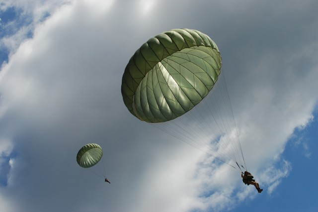 "Egyptian paratroopers sail to the ground during a ""friendship jump"" airborne operation at Fort Bragg, N.C., featuring airborne forces from five countries, including the U.S. 82nd Airborne Division. The jump was part of the Bright Star Exercise, a joint, multi-national training exercise being held at Fort Bragg from Sept. 28 - Oct. 12."