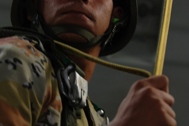 """An Egyptian paratrooper prepares to jump from a U.S. Air Force C-17 cargo plane during a """"friendship jump"""" airborne operation featuring airborne forces from five countries, including the U.S. 82nd Airborne Division. The jump was part of the Bright Star Exercise, a joint, multi-national training exercise being held at Fort Bragg, N.C., from Sept. 28 - Oct. 12."""