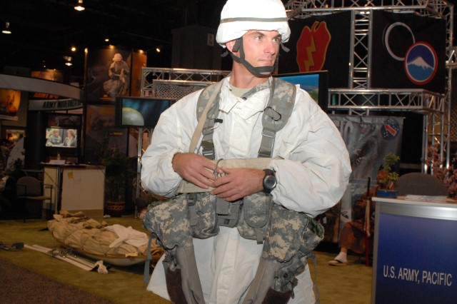 WASHINGTON D.C. -- Sgt. 1st Class David Bradley, United States Army, Alaska, demonstrates the proper wear of cold-weather gear issued to Soldiers stationed in Alaska during the Association of the United States Army Conference Oct. 5. Bradley and his Arctic Warriors were one of several cultural events held throughout the day at the United States Army, Pacific booth.