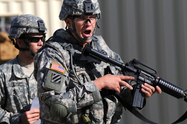 Sgt. 1st Class Aaron Beckman, representing U.S. Army Europe, reacts to an attack during the 'Evaluate a Casualty' Warrior Tasks and Battle Drills during the 2009 Department of the Army Best Warrior Competition held Sept. 28 - Oct. 2 at Fort Lee, Va.  Beckman was chosen as the 2009 Noncommissioned Officer of the Year during a ceremony on October 5th.