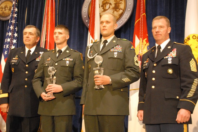 Army Vice Chief of Staff Gen. Peter W. Chiarelli poses with Spc. Clancy Henderson after presenting him the Soldier of the Year award.  Sgt. Maj. of the Army Kenneth O. Preston stands to the right of Sgt. 1st Class Aaron Beckman as he holds the 2009 Noncommissioned Officer of the Year award during a luncheon at the Association of the United States Army's annual meeting Oct. 5
