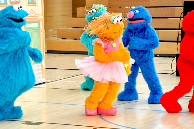 The Sesame Street cast performs a routine for the appreciative Wiesbaden audience.