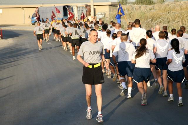 COL Dennis D. Doyle, Task Force 30th MEDCOM Commander, motivates 30th MEDCOM Servicemembers during the 30th MEDCOM's 76th Anniversary Run.