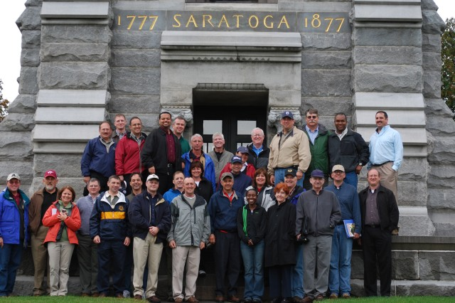 The staff ride participants gather around the Saratoga Monument, dedicated to the American victory over the British during the Saratoga Campaign in 1777.