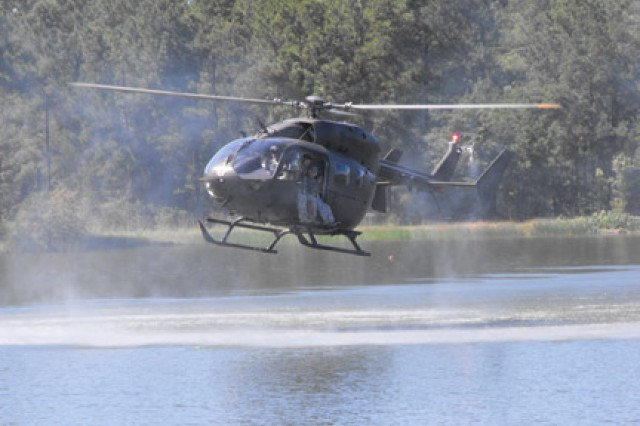 Jumpers from Yuma Testing Center, Yuma, Ariz., prepare to disembark a Lakota LUH over Alligator Lake during developmental testing of the aircraft's mission capabilities Sept. 30.