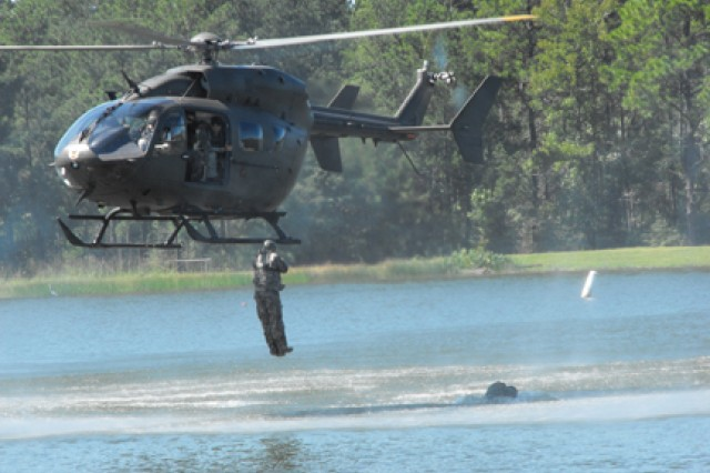 A test jumper from Yuma Training Center, Yuma, Ariz., exits a Lakota UH72A Light Utility Helicopter during developmental testing at Alligator Lake Sept. 30. The jump was part of a mission capabilities test for the Lakota and is the first official time the aircraft was used for helo cast. Static line parachute capabilities were also tested. S