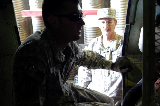 Spc. Jason E. Dean (left), a mechanic from Brooklyn, Miss., and Pfc. Joseph V. Morgan, a mechanic from Seminary, Miss., inspect the interior of an M1117 Armored Security Vehicle Sept. 30, after the ASV suffered a rollover during a mission. Both Soldiers serve with A Co., 106th Brigade Support Battalion, out of McGee, Miss. The company is attached to 2nd Battalion, 198th Combined Arms, at Q-West, Iraq, and the motor shop helps the 2/198th CAB keep 98-percent or more of combat vehicles fully-mission-capable.