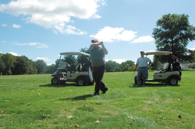 Vietnam veterans William Fosnaught, left, and Walt Kozloski tee off during the Joseph Gray Memorial Charity Golf Tournament for Wounded Warriors at Exton Golf Course Sept. 13.