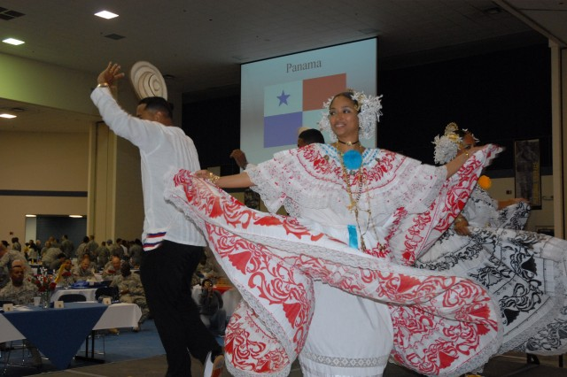 Members of the Brisas de Panama Dance Group twirl about the stage Tuesday at the Hispanic Heritage celebration luncheon at the Solomon Center. The event featured food, dance and cultural exhibits.