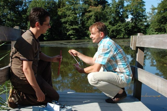 Chris Binje (L) and Hans Verwasch (R), of Schinnen's Environmental Division take water samples from the Schinnen Pond. The wetlands habitat is home to more than 60 endangered species.