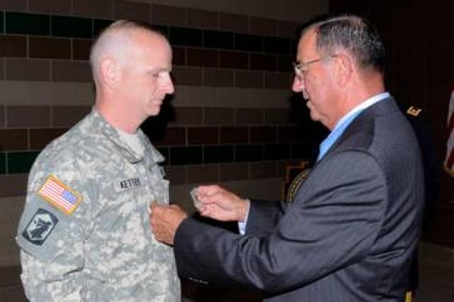 Capt. Kent Ketter of Chatham, Ill, is pinned by Jay R. Vargus of San Diego, Calif., a Medal of Honor Recipient on Sept 16 at the 404th MEB in Chicago, Ill. to major. Vargus was Ketter's Regimental Commander in the Marine Corps and is a Medal of Honor recipient.