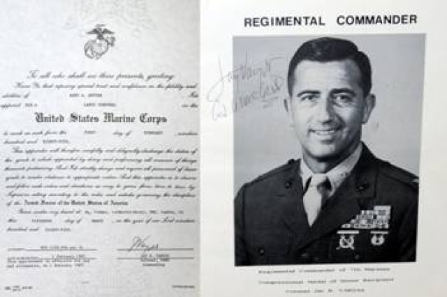 Maj. Kent Ketter kept a memorabilia book of his military career, to include his promotion to lance corporal in the Marine Corps. Jay R. Vargus of San Diego, Calif., a Medal of Honor Recipient pinned Ketter on Sept. 16 at the 404th MEB in Chicago, Ill.  Vargus was Ketter's Regimental Commander in the Marine Corps.