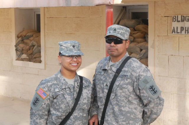 Dual military couple, Sgt. Michael Duffey (left), food service specialist, and Sgt. Kuuipo Duffey, chemical, biological, radiological and nuclear specialist, are both currently serving at Contingency Operating Site Diamondback with the Forward Support Company, 84th Engineer Battalion (Construction Effects).