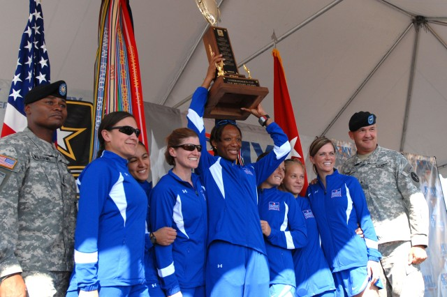 The Fort Bragg Women's Team celebrates winning top honors at the 25th Annual Army Ten-Miler in Washington D.C. Sunday (L-R: Command Sgt. Maj. Michael L. Williams, command sergeant major, U.S. Army Military District of Washington, Staff. Sgt. Danielle Sedillo, 1st Lt. Vanessa Najera, Capt. Jamie Dobson, Master Sgt. Angella Jackson, Spc. Kalynn Waltrip, Sgt. Nicole Smith, Maj. Michelle Ripka and Brig. Gen. Karl K. Horst, commanding general, U.S. Army Military District of Washington and former deputy commanding general XVIII Airborne Corps.) 2nd Lt. Grace Feldpausch was unavailable for the photo.