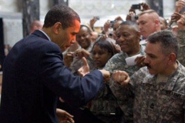 President Barack Obama receives a fist-bump from a U.S. soldier as he greets hundreds of U.S. troops  during his visit Tuesday, April 7, 2009, to Camp Victory, Iraq.