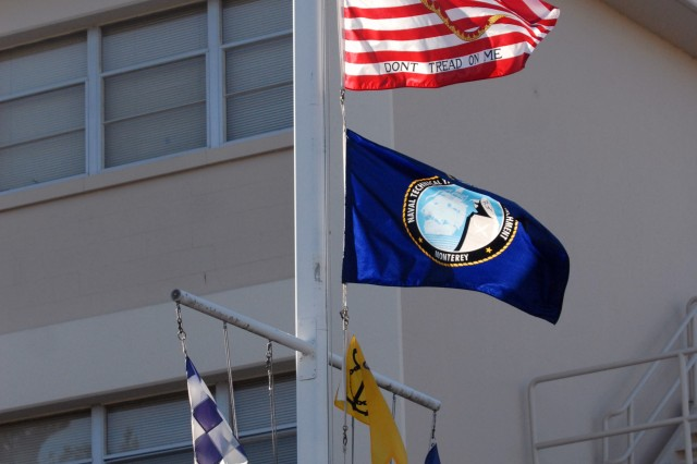 The First Navy Jack is flown in front of the CIDD headquarter building at the Presidio of Monterey.