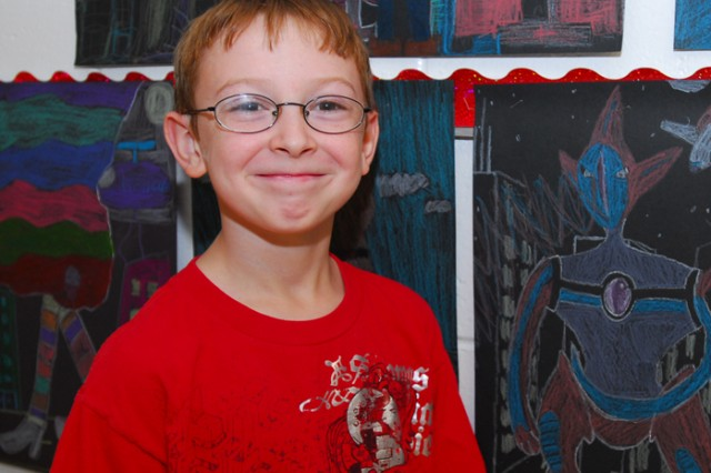 Michael Lewis was honored by former President Jimmy Carter at the Plains Peanuts Festival Parade Sept. 26. Michael won first place in the fifth-grade category of the Plains, Peanuts and a President art contest. There were approximately 21,000 entries in the annual contest, which coincides with the president's birthday celebration. Michael is a student at Morris R. McBride Elementary School.
