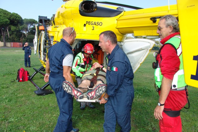"""Italian 118 first emergency responders prepare to airlift a simulated injured role player on a helicopter to a hospital in Florence during Exercise """"Tuscan Sun"""" Oct. 7."""