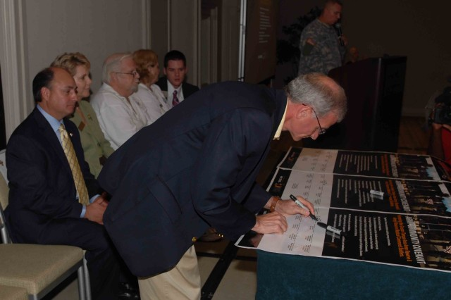 State Senator Mike Fasano (R, Dist. 11) signs the Army Community Covenant during a ceremony in Tampa.
