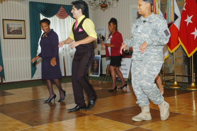 Jimmy Rumba (center), an Atlanta salsa instructor, teaches the salsa to Barbara Beach (left), Army Medical Department Professional Management Command, Capt. Sherry Crawford-Johnson (right), operations officer for G3, First Army Operations Center and Arlene Patterson (rear), secretary First Army Chaplain's Office, during a Hispanic Heritage celebration at the Fort Gillem Getaway club Oct. 2.