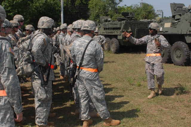 "CAMP BUNDELA, India (Oct. 10, 2009) - First Sgt. Devin Winnegan, senior enlisted Soldier for Troop B, 2nd Squadron, 14th Cavalry Regiment ""Strykehorse,"" 2nd Stryker Brigade Combat Team, 25th Infantry Division, from Schofield Barracks, Hawaii, addresses Soldiers with safety matters for driving their recently unloaded Stryker vehicles. The squadron is preparing for Exercise Yudh Abhyas 09 in Babina, India, Oct. 10. YA09, which is scheduled for Oct. 12-27, is a bilateral exercise involving the Armies of India and the United States. The primary goal of the exercise is to develop and expand upon the relationship between the Indian and U.S. Army."