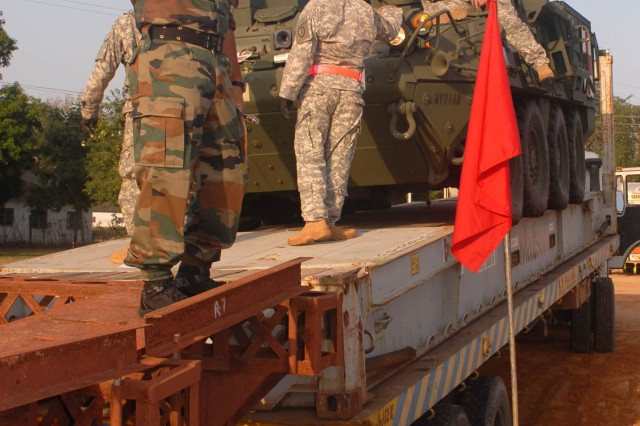 "CAMP BUNDELA, India (Oct. 10, 2009) - Soldiers from the 2nd Squadron, 14th Cavalry Regiment ""Strykehorse,"" 2nd Stryker Brigade Combat Team, 25th Infantry Division, from Schofield Barracks, Hawaii, work with the Indian Army soldiers assigned to the 7th Armored Mechanized Battalion, 94th Armored Brigade, 31st Armored Division, to prepare vehicles for unloading in preparation for Exercise Yudh Abhyas 09 in Babina, India, Oct. 10. YA09, which is scheduled for Oct. 12-27, is a bilateral exercise involving the Armies of India and the United States. The primary goal of the exercise is to develop and expand upon the relationship between the Indian and U.S. Army."