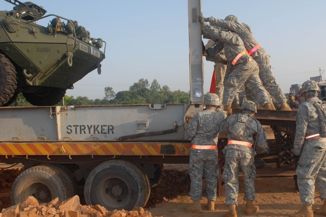 "CAMP BUNDELA, India (Oct. 10, 2009) - Soldiers assigned to  2nd Squadron, 14th Cavalry Regiment ""Strykehorse,"" 2nd Stryker Brigade Combat Team, 25th Infantry Division, from Schofield Barracks, Hawaii, prepare vehicles for unloading in preparation for Exercise Yudh Abhyas 09 in Babina, India, Oct. 10. YA09, which is scheduled for Oct. 12-27, is a bilateral exercise involving the Armies of India and the United States. The primary goal of the exercise is to develop and expand upon the relationship between the Indian and U.S. Army."