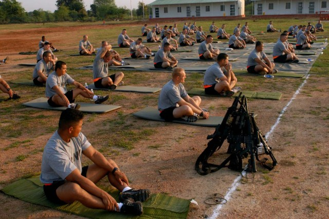 "CAMP BUNDELA, India- (Oct. 11, 2009) - Soldiers assigned to Troop B, 2nd Squadron, 14th Cavalry Regiment, ""Strykehorse,"" 2nd Stryker Brigade Combat Team, 25th Infantry Division listen to a yoga instructor during their yoga session at Camp Bundela in Babina, India, Oct. 11. The instruction is part of a cultural exchange between the Indian Army and the U.S. Army. The Soldiers are in India in support of Exercise Yudh Abhyas 09. YA09, which is scheduled for Oct. 12-27, is a bilateral exercise involving the Armies of India and the United States. The primary goal of the exercise is to develop and expand upon the relationship between the Indian and U.S."